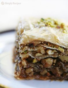 Baklava ~ Baklava pastry recipe, layers of phyllo dough filled with honey, walnuts and pistachios. Great recipe to make for a crowd! #MemorialDay #potluck~ SimplyRecipes.com
