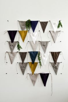 Fresh modern and so natural! Ten separate bunting flags that can be tied with each other or can also be tied separately. Hand made of natural linen fabric. It is a nice mix of natural gray+bow, white+flower, indigo, brown, mustard, violet and oatmeal linen flags. We can also tailor it in custom color-please feel free to contact us! Made with love and care in Europe for your Lovely Home! And have fun searching for new Lovely Home Ideas!