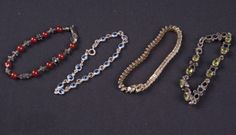 LOVELY GROUPING OF STYLISH BRACELETS INCLUDING A GOLD-PLATED BRACELET WITH DIAMONDS, A STERLING SILVER BRACELET WITH BLUE STONES, A STERLING SILVER WITH CARNELIAN BEADED BRACELET, AND A SILVER BRACELET WITH GREEN STONES.