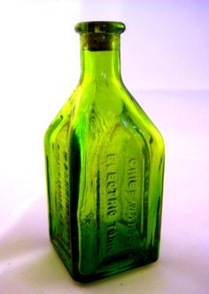 Miniature Green Bottle, Wheaton Glass  Chief Wahoo Electric Tonic, 70s collectible bottle