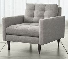 Petrie is a distinct living room chair that sits at the intersection of mid-century and today, with clean lines and tailored cushions expertly button-tufted by hand.