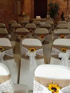 Beautiful hessian and lace chair sashes with bright sunflowers. www.elshamhallevents.co.uk