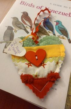I am a student at the University of California, Davis in Northern California. My roommate and I were walking to campus and saw something hanging off of a tree near the bus stops. I stopped to take a look and grabbed it. I found it to be surprisingly cute and well made. It will be well-loved and hanging off our fridge. #ifaqh #ifoundaquiltedheart