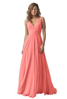 A coral-colored Watters crinkle chiffon bridesmaid dress with a shirred crisscross bodice and sash | Brides.com
