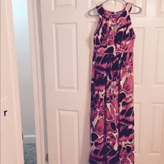 Bisou bisou long maxi dress This dress is 54inches in length. Has really cute detailing at the top front and back as well as a tie that helps accent your waist. 95% poly and 5% spandex. I wore it to a rehearsal dinner and one of the buttons came loose. I am going to include it with the dress. Bisou Bisou Dresses Maxi