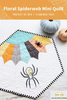 We have the perfect Halloween project for you to create! Check out this beautiful mini-quilt. It features a sweet floral spider and a colorful Dresden spiderweb. // Fall-Inspired Mini Quilt by Bev McCullough | Flamingo Toes @bevrmccullough // Project Instructions and Floral Design available to create this fun and cute Halloween sewing project
