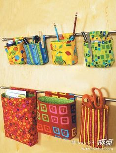 Image idea: hanging organizers on curtain rods ... Hmm. How might I use this in kitchen or craft room?