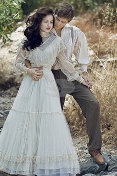 Young couple in Victorian costume holding one another Yeah...  I find this beautiful.