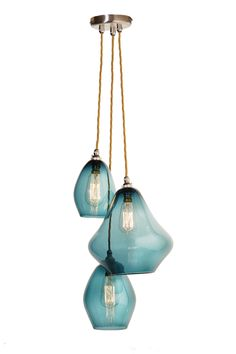Pear Drop Cluster in Teal. Graceful yet striking, the Pear Drop Cluster features three Pear Drops in small, medium and large. Here we've paired up Steel Blue glass with Celtic Gold flex — Curiousa & Curiousa Glass Pendant Light, Blown Glass Chandelier, Glass Pear, Colorful Glass Lighting, Ceiling Pendant Lights, Drop Lights, Glass Lighting Design, Drop Pendant Lights, Glass Lighting