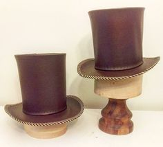 Brown top hats with striped band for Around the World in 80 Days Hat made by Lauren J Ritchie Designed by Lucy Wilkins Around The World In 80 Days, Around The Worlds, Top Hats, Opening Night, Hat Making, Candle Holders, It Cast, Band, Brown