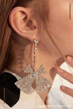 Pretty and Exclusive, these elegant Isabella Rhinestone decor Ribbon Drop Earrings feature a gleaming, abstract take on the charming ribbon shape that is instantly recognizable. #earringsforbridesmaids #jewelryforwedding #affordablestatementearrings #whatearringstowear #earringsideas #prettyearrings Aesthetic Fashion, Look Fashion, Big Earrings, Drop Earrings, Summer Purses, Hippie Jewelry, Summer Jewelry, Hippie Style, Statement Jewelry