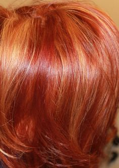 Done at Rain by Melodi Salon and Spa in Charlotte, NC with Tocco Magico.  This Summer's RED dimension!