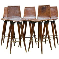 1960s Midcentury Leather Sling Iron Bar Stools   From a unique collection of antique and modern stools at https://www.1stdibs.com/furniture/seating/stools/