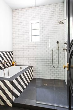 Bold, diagonally striped concrete tiles from Granada Tile enliven a children's bathroom | archdigest.com