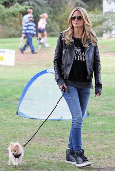 Heidi Klum rocking a leather jacket with sneakers