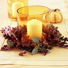 Two-Step Candle Centerpiece-Two-Step Candle Centerpiece  Turn a simple votive candle into a sophisticated display by adding nature's bounty.  How to Make It  -- Set a candle in an amber glass holder and ring the outside with moss, oak leaves, acorns, and red berries.  -- Add sprigs of seeded eucalyptus (available at floral shops) for its fragrance and fresh gray-green color.