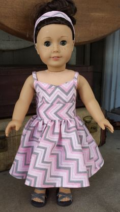 Pink and gray wrap dress made with the Wrap Top Dress pattern. Find it at http://www.pixiefaire.com/products/wrap-top-dress-18-doll-clothes. #pixiefaire #wraptopdress