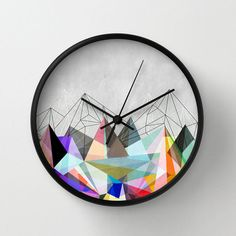 """Color Spike Clock   dotandbo.com $28.99 QUALITIES  Dimensions: 10"""" Diam. x 1.75"""" D  Materials: Wood, high-impact plexiglass crystal face  Uses: 1x AA battery (not included)  Installation: Wall mount with backside hook for hanging  Artist: Mareike Böhmer Graphics"""