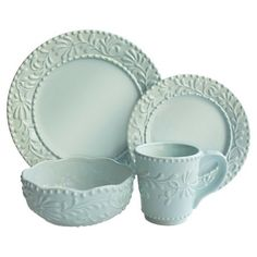 An elegant stage for your culinary creations, this eye-catching earthenware dinner set showcases a raised vine motif in blue mist.