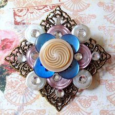 Beautiful button brooch with filagree and gems