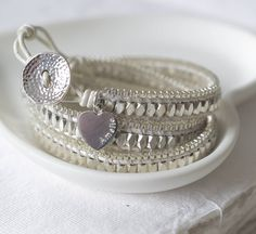 A gorgeous personalised wrap bracelet finished in white leather leather finished with a sterling silver heart charm. £49.00 from notonthehighstreet