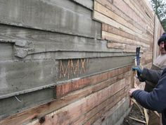 board formed concrete- I like the roughness and uneven pattern. love the initials formed in there! Concrete Fence Wall, Concrete Siding, Concrete Formwork, Concrete Wall Texture, Board Formed Concrete, Concrete Retaining Walls, Concrete Forms, Concrete Fireplace, Concrete Houses