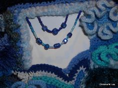 Close up of my handmade glass beads (lampwork) added to the wall hanging