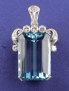 Platinum, Aquamarine, and Diamond Pendant/Pin, centering a rectangular cut-cornered aquamarine measuring 21.25 x 14.85 x 8.85 mm, highlighted by full-cut diamonds, with silver trace link chain.
