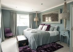 Green and purple boutique bedroom interior at Coral Beach House in Angmering-On-Sea, West Sussex