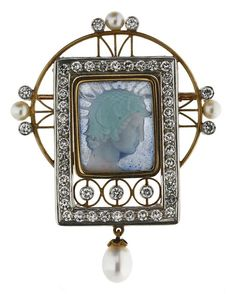 MASRIERA ART NOUVEAU OPAL BROOCH. Gold, with an Opal plaque, accented with diamonds and pearls.