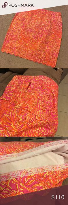 1990's Lilly Pulitzer Skirt Rare pattern.  Looks random at first and then you can see tigers.  Size 14.  Measures 16 inches across waist and 22 inches across hips. Measures 21 inches top to bottom.  Has a back pocket. Scalloped on the bottom.  Please ask questions, open to reasonable offers. Lilly Pulitzer Skirts