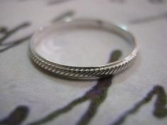 Stacking ring made of rope texture sterling silver.    For a perfect fit, please specify your ring size. All sizes are available!    ***You