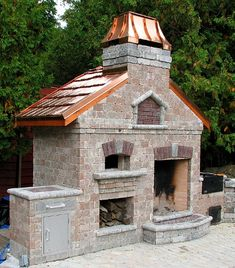 Outside patio cooking complex consisting of brick oven, fire open fireplace, cold smoker, and charcoal BBQ. lpdinc