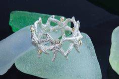 Hey, I found this really awesome Etsy listing at http://www.etsy.com/listing/156617408/starfish-ring-w-diamond-accents-crafted