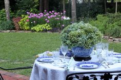 Dinner in the Garden - blue white china, crystal, hydrangea & silver: gorgeous!  Living With Thanksgiving blog: