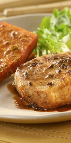 Tender pork chops and sweet potato drizzled with a maple-mustard sauce flavored with oregano