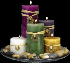 Varying candle heights in your varying wedding colours on a wood plate