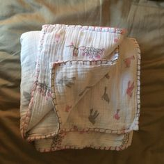 Upcycled muslin wraps to toddler blanket. Had so many spare wraps and was looking for a light summer blanket for Miss 2. Used cotton batting, 2 wraps, stitched around with quilting foot and finished with a blanket stitch.