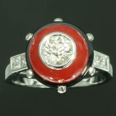 Art Deco style estate platinum engagement ring with diamond onyx and coral