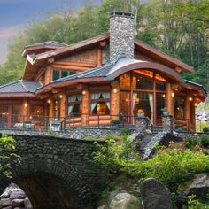 Beautiful Log Cabin on a Bridge {love the creek stone bridge, stairs, walls, & chimeny}