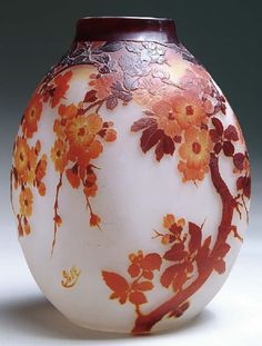 IMAGE: A large Galle cameo vase featuring brown, yellow and amber cherry…