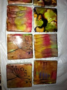 mini tiles using alcohol ink. Need to waterproof them using a varnish/ sealer, but I love how organic they are. Add stamps for detail on teh odd one.