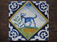 An Authentic Dutch Delft tile with a polychrome domestic dog with dogcollar...