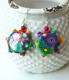 A personal favorite from my Etsy shop https://www.etsy.com/listing/293804427/modern-colorful-earrings-flower-earrings