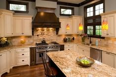 Venetian Gold granite with tile backsplash and light cabinets... Nice mix of colors brown and white. I have these cabinets in my Kitchen. THinking of these countertops and backsplash.