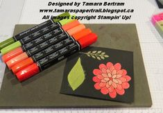 Stamp on black card with flower patch and emboss with white embossing powder . Then colour over top with blendabilities