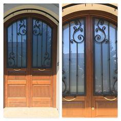Decoro in ferro battuto per porta d'entrata a disegno del cliente. Finitura Antracite.