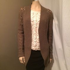 Gold and Brown Long Belted Cardigan Beautiful open knit cardigan that would be perfect for the holidays! So incredibly soft, this brown cardigan has flecks of gold thread throughout the open knit weave. Features a belt that you can tie around either your waist or behind your back and would be easy to dress up or down. Nylon and wool blend. LOFT Sweaters Cardigans