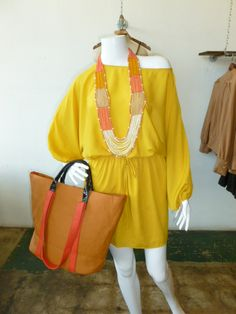 Mustard off the shoulder dress with elastic waist!  Beaded necklace and colorblock bag also available!