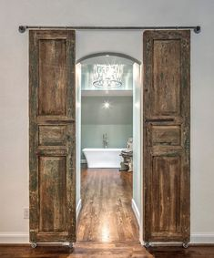 Now this is a Master Bath entry! #Inspiration #barndoors #masterbath #customcarpentry #greenbasementsandremodeling